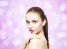 Portrait of young, beautiful and healthy woman: over pink background. Healthcare, spa, makeup and face lifting concept Stock Photography