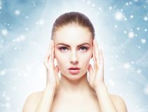 Portrait of young, beautiful and healthy woman over winter Christmas background. stock image