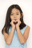 Portrait of young beautiful hipster girl. Making heart symbol by finger hand Stock Image