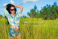 Portrait of young beautiful hispanic girl on a grass field Royalty Free Stock Images