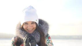 Portrait of young beautiful joyful woman outdoors enjoying winter day looking into the camera Stock Photos