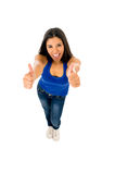 Portrait of young beautiful latin woman giving thumb up happy and excited Stock Photos