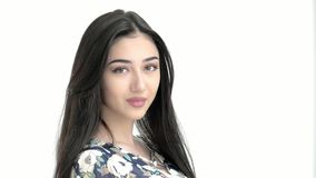 Portrait young beautiful Middle eastern model girl looking at the camera.brunette correct her hair concept fashion and beauty. Portrait young beautiful Middle stock footage