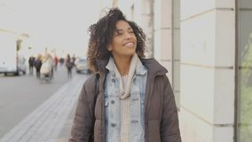 Portrait of young beautiful mixed race woman with afro haircut walking stock video footage