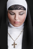 Portrait of the young beautiful nun stock photography