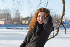 Portrait of a young beautiful red hair european girl smiling at camera Royalty Free Stock Photography