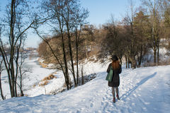 Portrait of a young beautiful red hair european girl walking in the snowy park. In Ukraine Royalty Free Stock Image