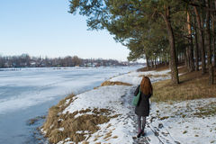 Portrait of a young beautiful red hair european girl walking on snowy road in winter forest. In Ukraine Royalty Free Stock Photos