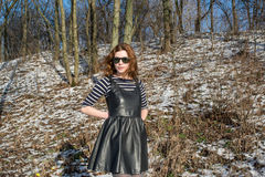 Portrait of a young beautiful red hair european girl wearing sunglasses. In Ukraine Stock Images