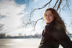 Portrait of a young beautiful red hair european girl during winter season looking at camera Royalty Free Stock Photo