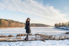 Portrait of a young beautiful red hair european girl in winter season Stock Photography