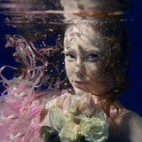 Portrait of young beautiful red hair girl underwater Royalty Free Stock Photos