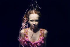 Portrait of young beautiful red hair girl underwater Royalty Free Stock Photo
