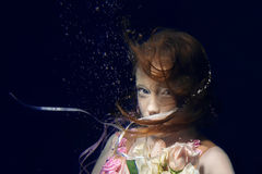 Portrait of young beautiful red hair girl underwater Stock Image