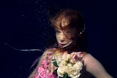 Portrait of young beautiful red hair girl underwater Royalty Free Stock Photography