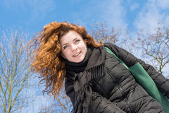 Portrait of a young beautiful red hair smiling  european girl at winter season Stock Photo