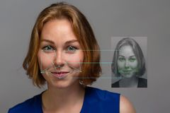 Portrait of a young beautiful red hair woman on a grey background with mini-portrait. Biometric verification, face concept. Copy stock images