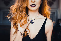 Portrait of young beautiful red-haired girl in the image of a Gothic witch on Halloween Stock Photos