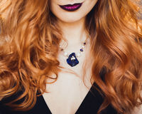 Portrait of young beautiful red-haired girl in the image of a Gothic witch on Halloween Royalty Free Stock Image