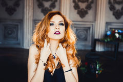 Portrait of young beautiful red-haired girl in the image of a Gothic witch on Halloween Royalty Free Stock Photos