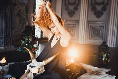 Portrait of young beautiful red-haired girl in the image of a Gothic witch on Halloween Stock Images