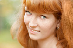 Portrait of young beautiful red-haired woman Stock Images