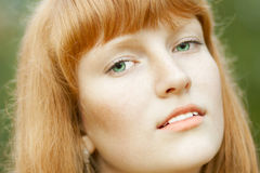 Portrait of young beautiful red-haired woman Royalty Free Stock Photos