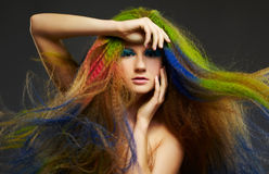 Long-haired curly redhead woman Royalty Free Stock Photography