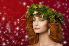 Portrait of young beautiful redhaired woman with firry wreath Royalty Free Stock Photography