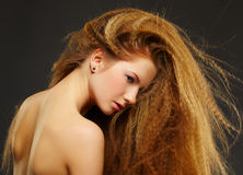 Long-haired curly red-haired woman Stock Photography