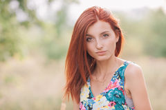 Portrait of a young beautiful redhead woman Royalty Free Stock Images