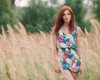 Portrait of a young beautiful redhead woman Stock Photo