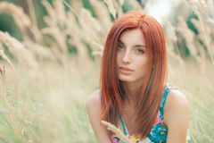 Portrait of a young beautiful redhead woman Stock Image