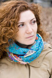Portrait of a young beautiful redheaded girl in a bright scarf Royalty Free Stock Image