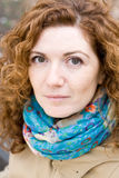Portrait of a young beautiful redheaded girl in a bright scarf Stock Photos