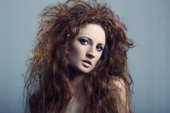 Portrait of a young beautiful redheaded woman Stock Image