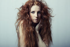 Portrait of a young beautiful redheaded woman Royalty Free Stock Photography