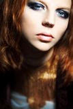 Portrait of young beautiful redheaded woman, close Royalty Free Stock Photography