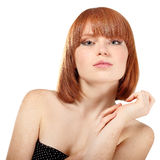 Portrait of young beautiful redheaded woman hoolding hand near h Stock Images