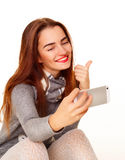 Portrait of young beautiful smiley woman making selfie over whit Royalty Free Stock Images