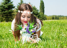 Portrait of the young beautiful smiling woman with long hair and flowers outdoors. Portrait of the young beautiful smiling woman with long hair and flowers stock photos