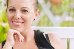 Portrait of young beautiful smiling woman stock photo