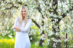 Portrait of the young beautiful smiling woman outdoors Stock Image