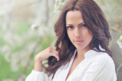 Portrait of the young beautiful smiling woman outdoors Royalty Free Stock Image