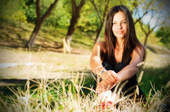 Portrait of young beautiful smiling woman outdoors, enjoying Stock Images