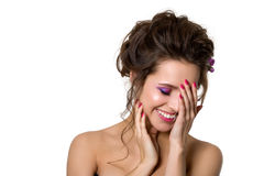 Portrait of young beautiful smiling woman touching her face Stock Photography