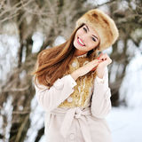 Portrait of young beautiful smiling woman in winter Royalty Free Stock Image