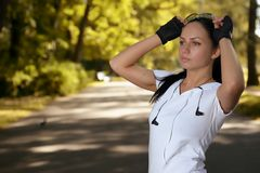 Portrait of young beautiful sports girl in park Royalty Free Stock Photography