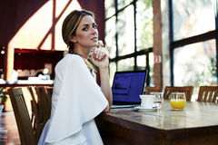Portrait of a young beautiful Sweden woman relaxing after work on her laptop computer during coffee break Royalty Free Stock Photography