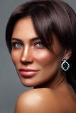Young beautiful tanned woman with freckles stock images